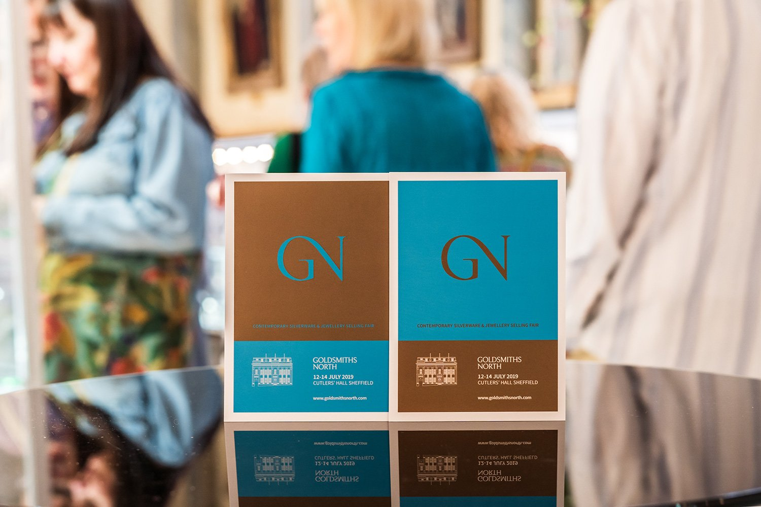 Goldsmiths North 2019 flyers in cyan and gold.